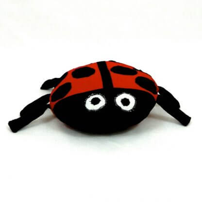 ladybug cushion with dangly legs and soft finish