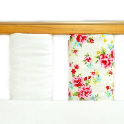 Floral cot bar bumpers set in pink and cream