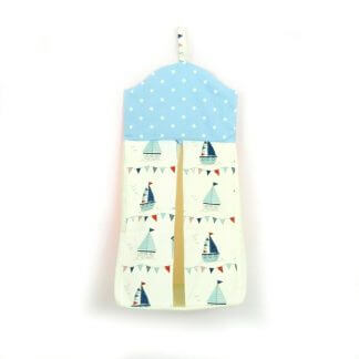 Nautical nappy stacker with seaside illustrations.