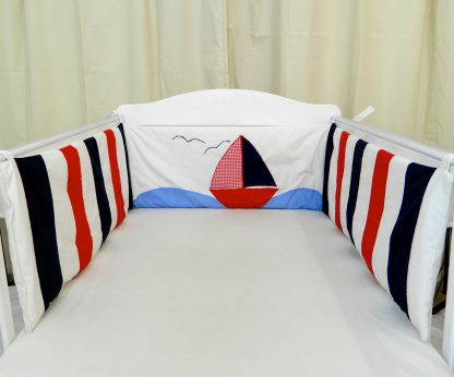 Cot bumper with a nautical sailing boat in red, navy and white