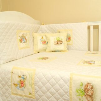 Beatrix Potter baby bedding with cream squares