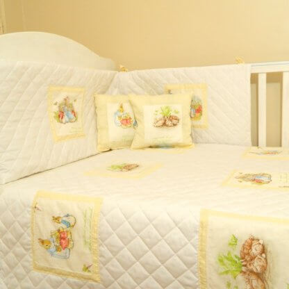 Beatrix Potter quilted baby bedding with cream squares