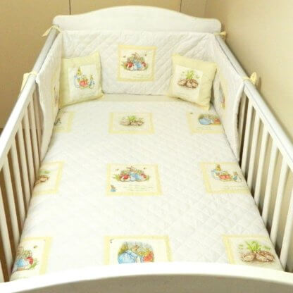 Neautral Beatrix Potter baby bedding with cream dotty squares