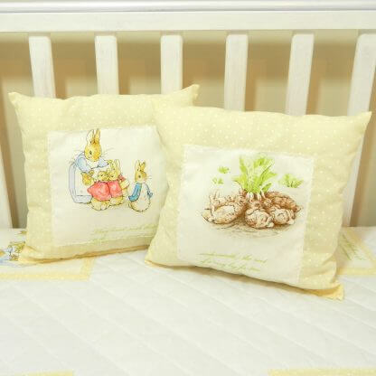 Cream Peter Rabbit cushions set of two.