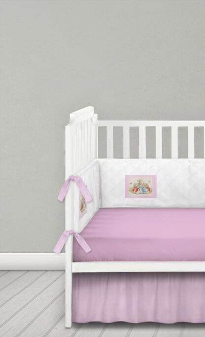 White quilted cot bumper with pink Beatrix Potter squares