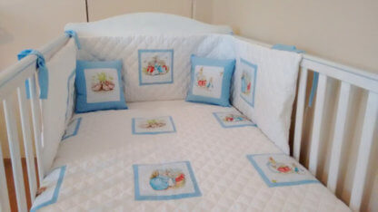 Beatrix Potter baby bedding with white and blue squares