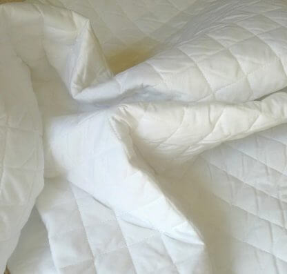 White quilted quilt