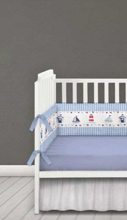 Blue and white gingham cot bumper with seaside illustrations