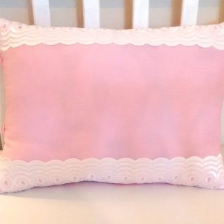 Girls pink cushion with white pretty lace