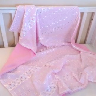 Pink fleece blanket with white lace