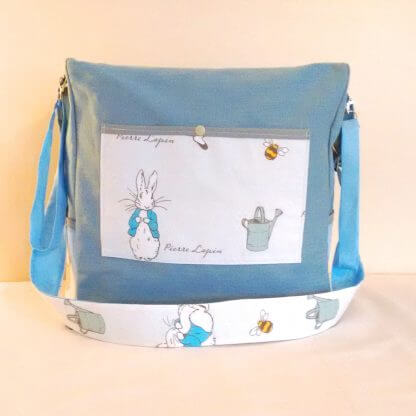 Blue canvas bag with Peter rabbit illustrations