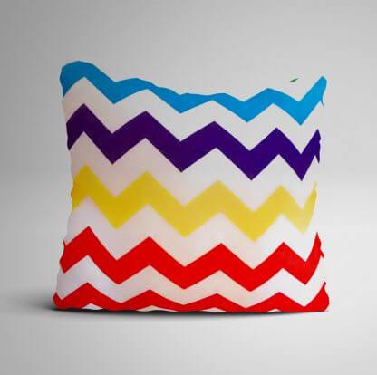 Multi coloured cushion with plain white backing