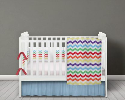 Multi coloured chevron baby bedding set in bright chevron design.