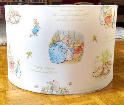 White Beatrix Potter lamp shade.
