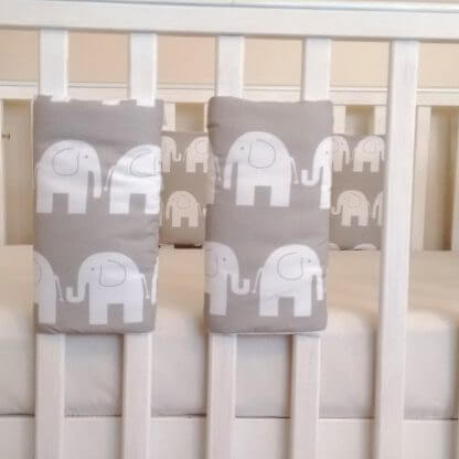 White and grey elephant cot bar bumpers set