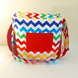 Multi coloured chevron baby nappy bag in bright chevron pattern.