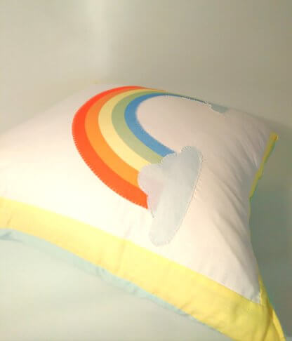 Rainbow themed cushion with yelow border