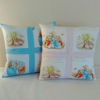 Gingham Beatrix Potter children's cushions in pink and blue