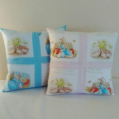 Beatrix Potter children's cushions in pink and blue gingham fabric