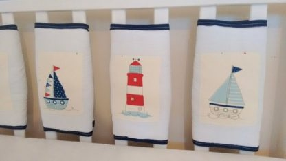 White nautical cot bar bumpers set with navy trim