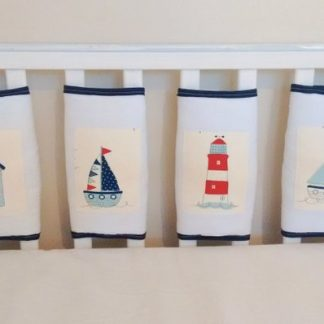 Nautical themed cot bar bumpers in white and navy.