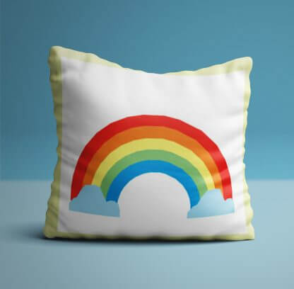Rainbow children's cushion with yellow edging.