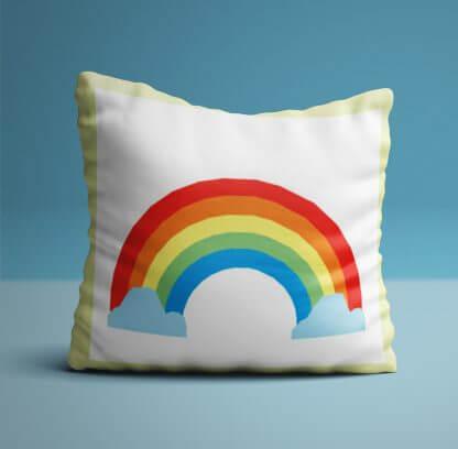 Rainbow children's cushion with yellow edging.