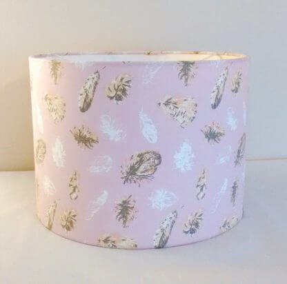 Pastel pink lampshade with delicate feathers