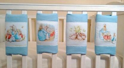 Blue Beatrix Potter cot bar bumpers in blue