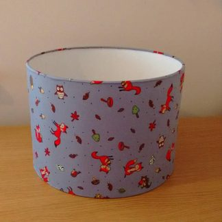 Woodland themed children's lampshade in grey with woodland animals.