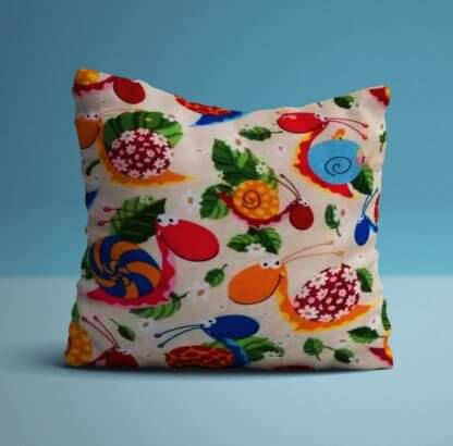 Snail themed cushion in bright colours