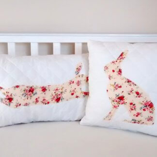 Quilted cushion with floral rabbits