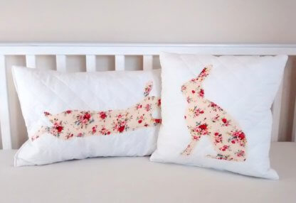 Quilted cushion with floral rabbit