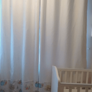 White curtains with Beatrix Potter panel at the bottom