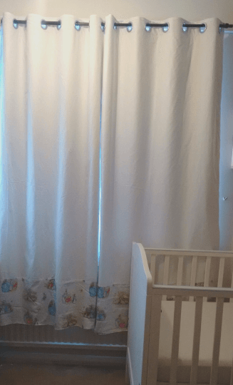 White curtains with Beatrix Potter panel