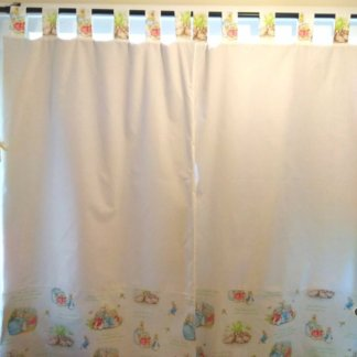 Tab top curtains with Beatrix potter illustrations