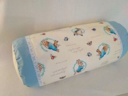 Peter Rabbit bolster cushion in blue and yellow