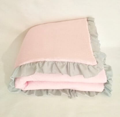 Baby girls pink quilt with frill