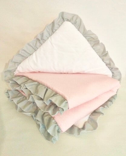 Baby girls quilt in pink with frill