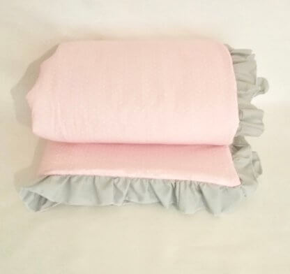 Pink baby girls spotty quilt with grey frill