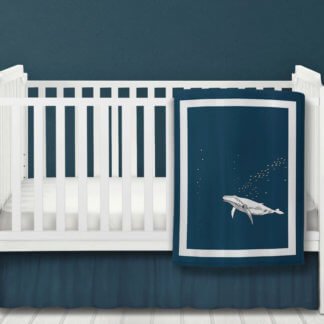 Baby quilt with a whale print in navy and white