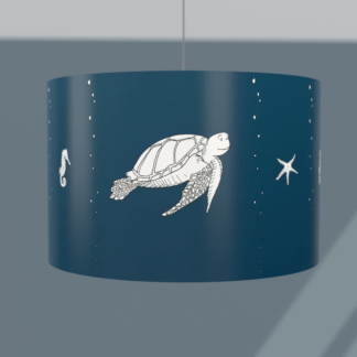 Under the sea themed lampshade in navy with white sea creatures.