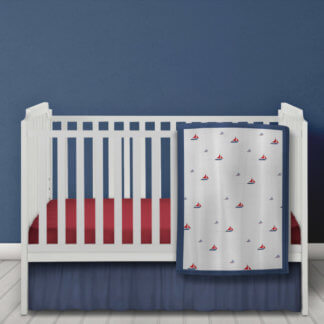 Sailing boat baby quilt in white and navy.