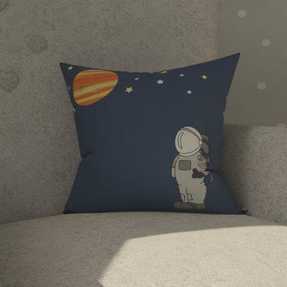 Spaceman cushion in navy.